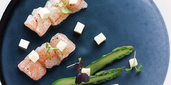 Large marinated langoustines with asparagus and cream