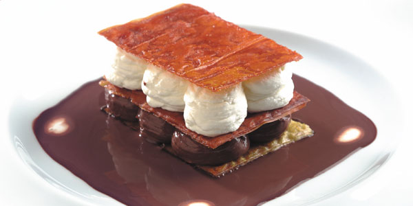 Flaky chocolate desserts in the style of a patissier's 'Mille Feuilles'