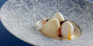 Soft-boiled quails' eggs with browned mature Mimolette, chorizo and olive pieces