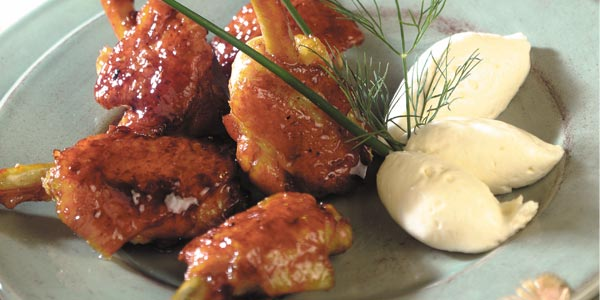 Poultry wings With a honey and coriander glaze served with cream