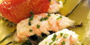 Langoustine parcels with butter, tomatoes in oil, fresh herbs and baby white onions