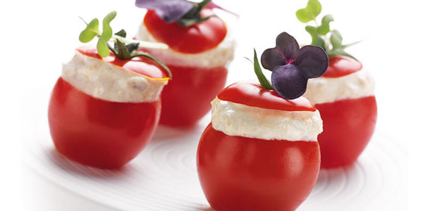 Cherry tomatoes stuffed with fromage blanc and mustard