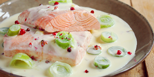 Salmon with cream, leek, and pink berries